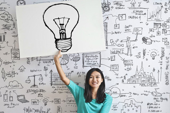 woman holding up light bulb